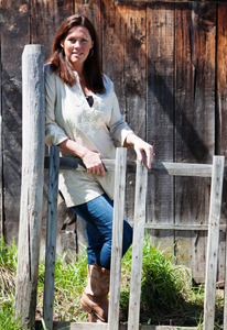Laura Munson by the fence on her Montana ranch