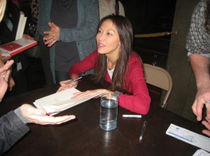 Amy Chua at KPFA event signing books