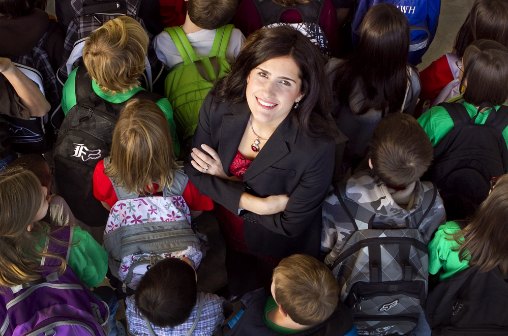 Tama Clapper, Blessings in a Backpack: News Record Photo by Alton Strupp