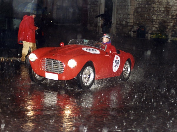 Sylvia Oberti driving in the rain in the Mille Miglia