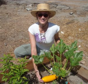 Cyndi Hubach with zucchini in her community garden/Photo: Stacey Gualandi