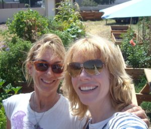 Cyndi Hubach and Stacey Gualandi in Cyndi's Community Garden