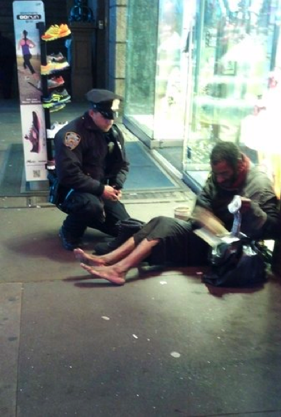 NYPD Officer Lawrence DePrimo buys new boots for a homeless man in Times Square   Photo: Jennifer Foster