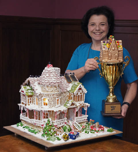 Laura Morrissette with her award-winning eco-friendly gingerbread house and her trophy