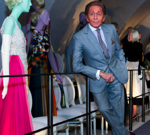 Valentino posing on the catwalk of his exhibition