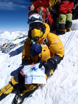 Cindy Abbott on Everest holding Rare Disorders Banner/Photo: Scott Woolums