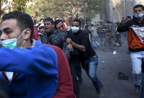 The wounded are evacuated as protesters clashed with Egyptian military as a crowd of tens of thousands filled Cairo's Tahrir Square/Photo: Heidi Levine, Sipa Press