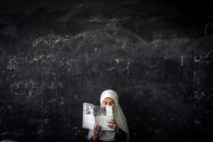 Afghan Girl Reading in Afghan School/Photo: Sergey Ponomarev for The New York Times