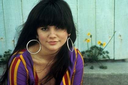 Linda Ronstadt wearing favorite dress she wore for years,wadding it up in purse in case airlines lost it/Photo: Henry Diltz
