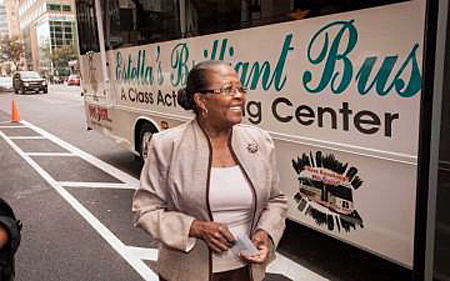 Estella Pyfrom standing in front of her Brilliant Bus, bridging the digital divide by bringing computer access to underserved communities | Photo: Christopher Bivens