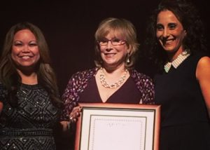 Tech Journalist Andrea Smith winning Lwegacy Award at 2015 CES Show flanked by michelle Troupe and Deena Ghazarian