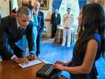 Haben Girma talking to President Obama using digital Braille device/White House Photo courtesy Haben Girma