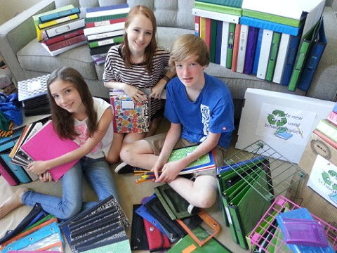 Coleen Christian Burke;s chikldren Brfenna, Maeva, J. collecting school supplies/Photo: Coleen Christian Burke