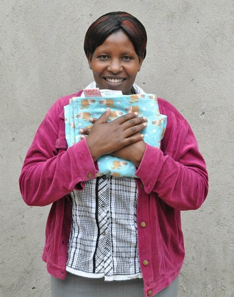 Andra Good's Leigh's Blankies group gives blankie to person in Africa/Photo on Andra's website