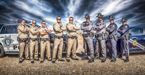 """Photo of Las Vegas first responders from Metro Police and Nevada Highway Patrol with fallen off-duty officer, Charleston Hatfield """"ghosted"""" in (far left) 