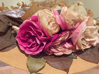 Flower straw hat by Maison Virot, plaited over wire frame, silk artificial roses and ferns ca. 1900 at Legion of Honor/Photo: Courtesy Wendy Verlaine