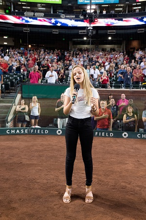 Evie Clair singing at Arizona Diamondbacks pregame