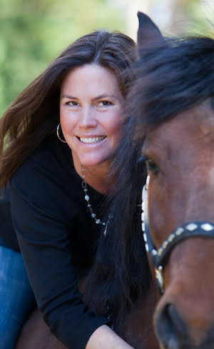 "Laura Munson, author of ""Willa's Grove"" on her horse 