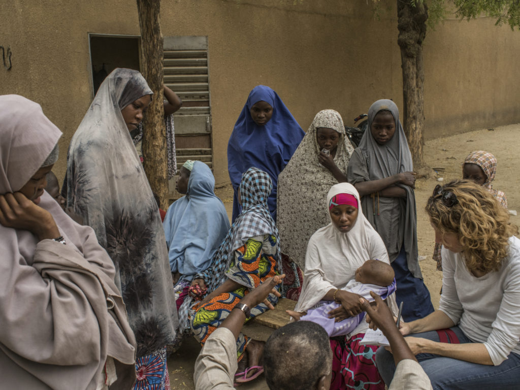 Dionne Searcey in Niger taking notes for a story/Photo: Laura Boushnak