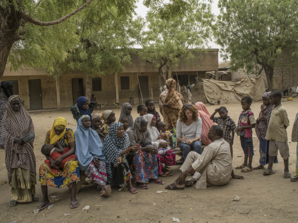 Journalist Dionne Searcey in Niger with Zalika to the left with her baby/Photo: Laura Boushnak